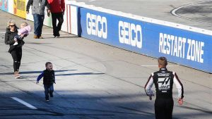 Clint Bowyer's son Cash runs toward him.