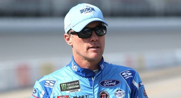 Kevin Harvick gazes into the distance as he walks on the grid.