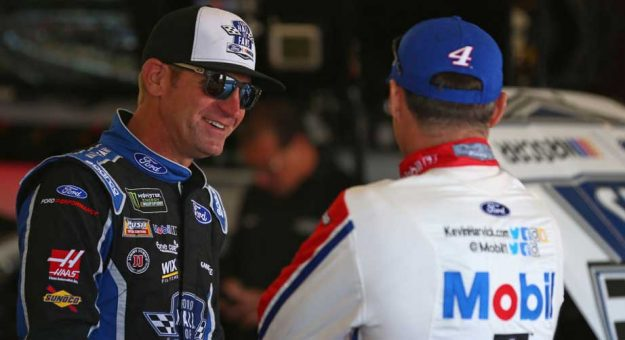 Clint Bowyer talks to Kevin Harvick in the Richmond garage