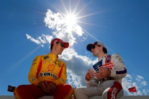 Joey Logano talks with Ryan Blaney