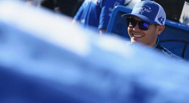 Kyle Larson in Credit One hat