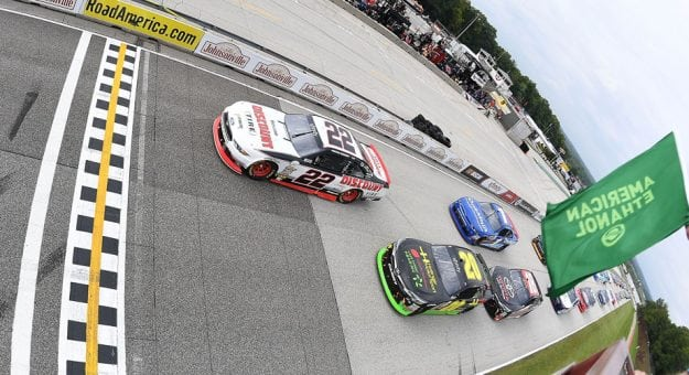 Cars start at the green flag at Road America