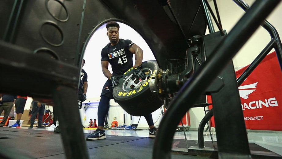 Joshua Patrick changing a tire