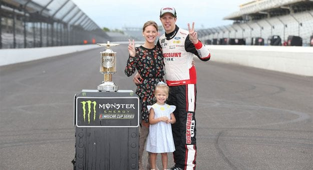 Brad Keselowski and family pose after a win