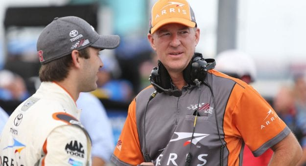 Scott Graves chats with driver Daniel Suarez in the garage.