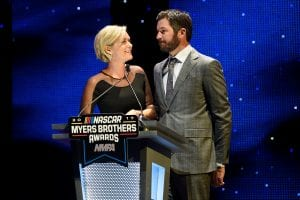 LAS VEGAS, NV - NOVEMBER 29: Martin Truex Jr., and his girlfriend Sherry Pollex speak on stage after accepting the Myers Brothers Award during the NASCAR NMPA Myers Brothers Awards at the Encore Theater at Wynn Las Vegas on November 29, 2017 in Las Vegas, Nevada. (Photo by David Becker/Getty Images) | Getty Images