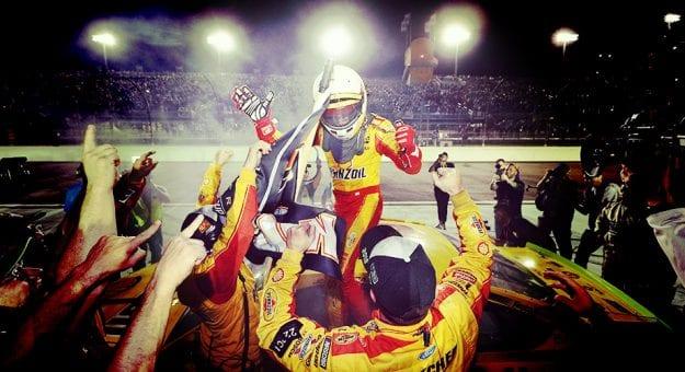 Joey Logano celebrates with his team