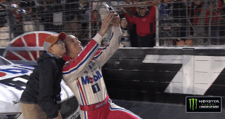 Harvick takes selfie, gives checkered flag to young fan