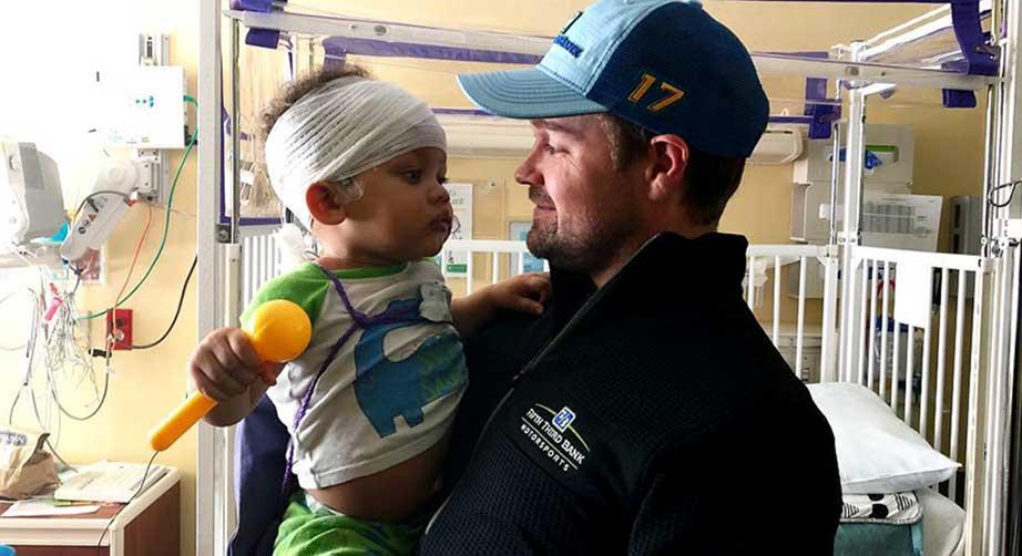 Ricky Stenhouse Jr. holds a patient