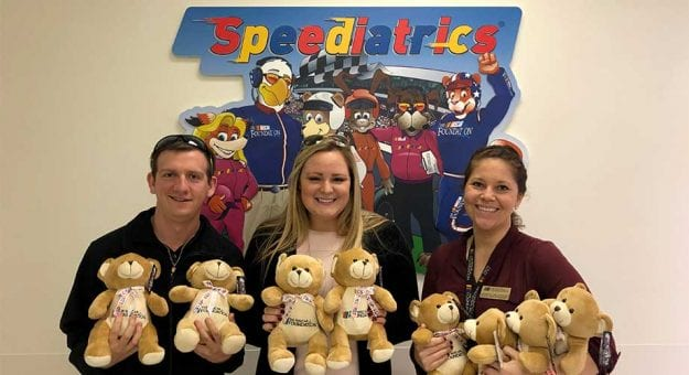 Volunteers helped hand out Speedy Bears on Giving Tuesday