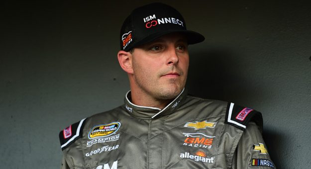 Johnny Sauter sits backstage at driver introductions at Texas.