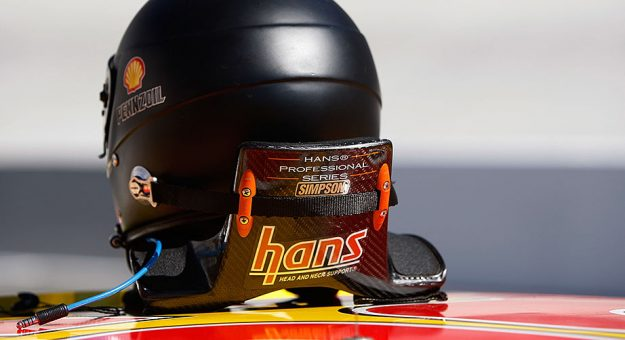 The Head and Neck Support (HANS) system.