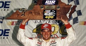 Tony Stewart hoists the trophy after winning at Richmond Raceway in 1999.