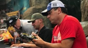 Clint Bowyer and Ryan Newman sign autographs at an appearance.