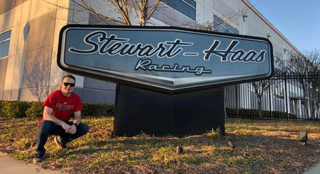 Ryan Hines poses outside the Stewart-Haas Racing entrance in Kannapolis, N.C.