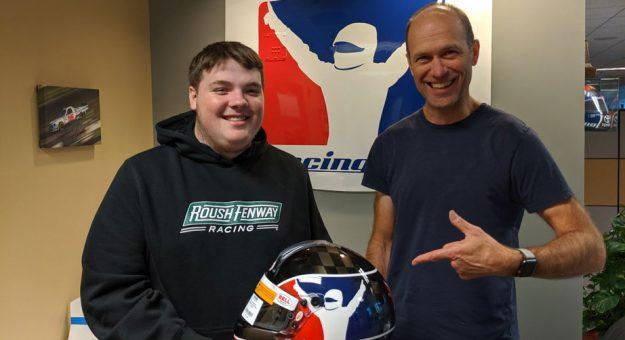 Zack Novak poses with iRacing helmet