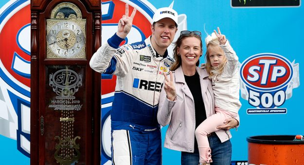 MARTINSVILLE, VA - MARCH 24:  Brad Keselowski, driver of the #2 Reese/Draw Tite Ford, celebrates with his wife Paige and their daughter Scarlett in Victory Lane after winning the Monster Energy NASCAR Cup Series STP 500 at Martinsville Speedway on March 24, 2019 in Martinsville, Virginia.  (Photo by Brian Lawdermilk/Getty Images) | Getty Images
