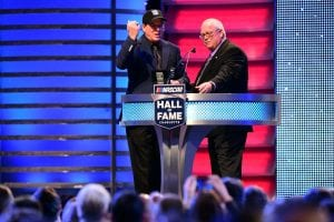 CHARLOTTE, NC - JANUARY 19: NASCAR Hall of Fame inductee Ron Hornaday Jr. (L) reacts as NASCAR XFINITY Series Managing Director Wayne Auton presents him with his ring during the NASCAR Hall of Fame Induction Ceremony at Charlotte Convention Center on January 19, 2018 in Charlotte, North Carolina. (Photo by Jared C. Tilton/Getty Images) | Getty Images