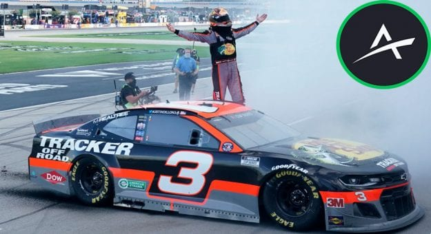Austin Dillon stands on door of car after Texas win with Action Network logo in upper right