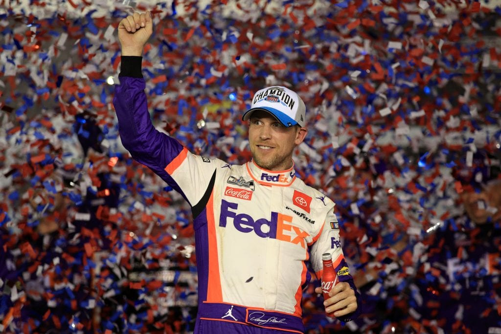 DAYTONA BEACH, FLORIDA - FEBRUARY 17: Denny Hamlin, driver of the #11 FedEx Express Toyota, celebrates in Victory Lane after winning the NASCAR Cup Series 62nd Annual Daytona 500 at Daytona International Speedway on February 17, 2020 in Daytona Beach, Florida. (Photo by Chris Graythen/Getty Images) | Getty Images