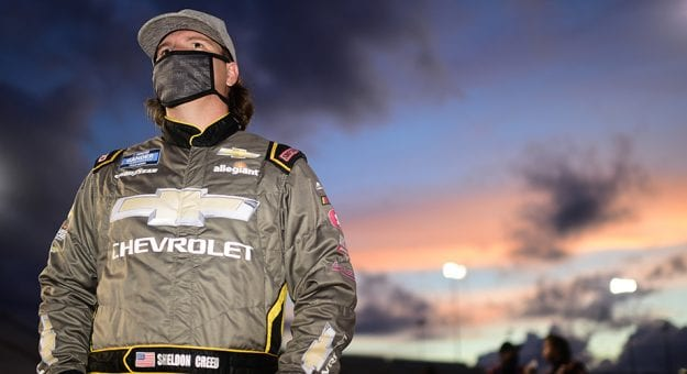 RICHMOND, VIRGINIA - SEPTEMBER 10: Sheldon Creed, driver of the #2 Chevy Accessories Chevrolet, waits on the grid prior to the NASCAR Gander Outdoors Truck Series ToyotaCare 250 at Richmond Raceway on September 10, 2020 in Richmond, Virginia. (Photo by Jared C. Tilton/Getty Images) | Getty Images