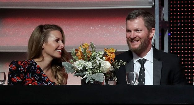 CHARLOTTE, NC - DECEMBER 08:  Dale Earnhardt Jr. sits alongside his wife Amy during the NASCAR XFINITY and Truck Series Banquets at Charlotte Convention Center on December 8, 2018 in Charlotte, North Carolina.  (Photo by Streeter Lecka/Getty Images) | Getty Images