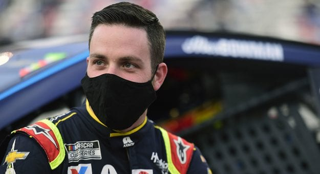 BRISTOL, TENNESSEE - SEPTEMBER 19: Alex Bowman, driver of the #88 Axalta Chevrolet, stands on the grid prior to the NASCAR Cup Series Bass Pro Shops Night Race at Bristol Motor Speedway on September 19, 2020 in Bristol, Tennessee. (Photo by Jared C. Tilton/Getty Images)   Getty Images