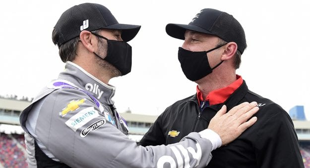 AVONDALE, ARIZONA - NOVEMBER 08: Jimmie Johnson, driver of the #48 Ally Chevrolet, and crew chief Chad Knaus embrace on the grid prior to the NASCAR Cup Series Season Finale 500 at Phoenix Raceway on November 08, 2020 in Avondale, Arizona. Jimmie Johnson is scheduled to retire from full-time NASCAR racing after 2020.  (Photo by Jared C. Tilton/Getty Images) | Getty Images