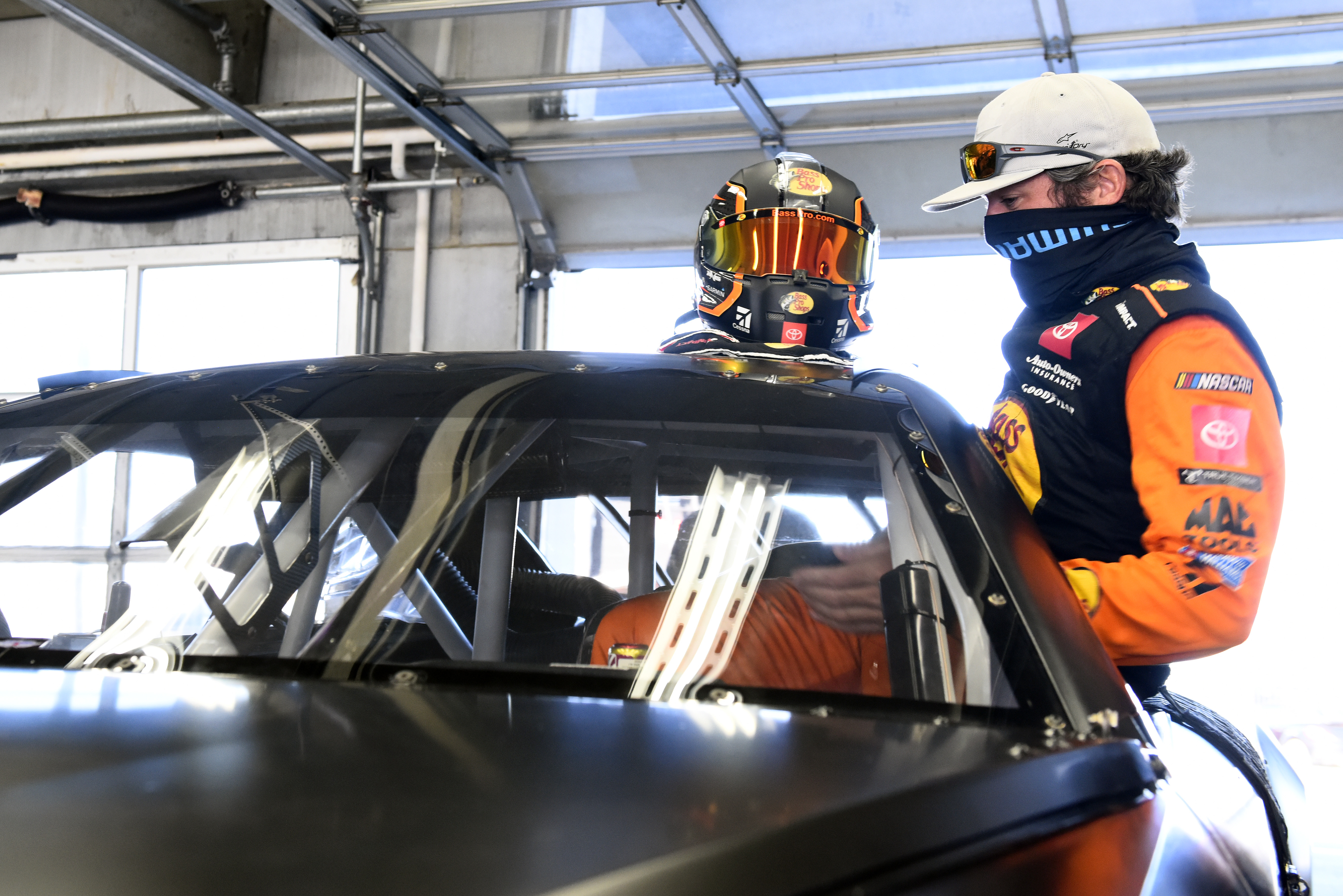CONCORD, NORTH CAROLINA – NOVEMBER 16: Martin Truex Jr. climbs into the NASCAR Next Gen car during the NASCAR Cup Series test at Charlotte Motor Speedway on November 16, 2020 in Concord, North Carolina. (Photo by Jared C. Tilton/Getty Images) | Getty Images