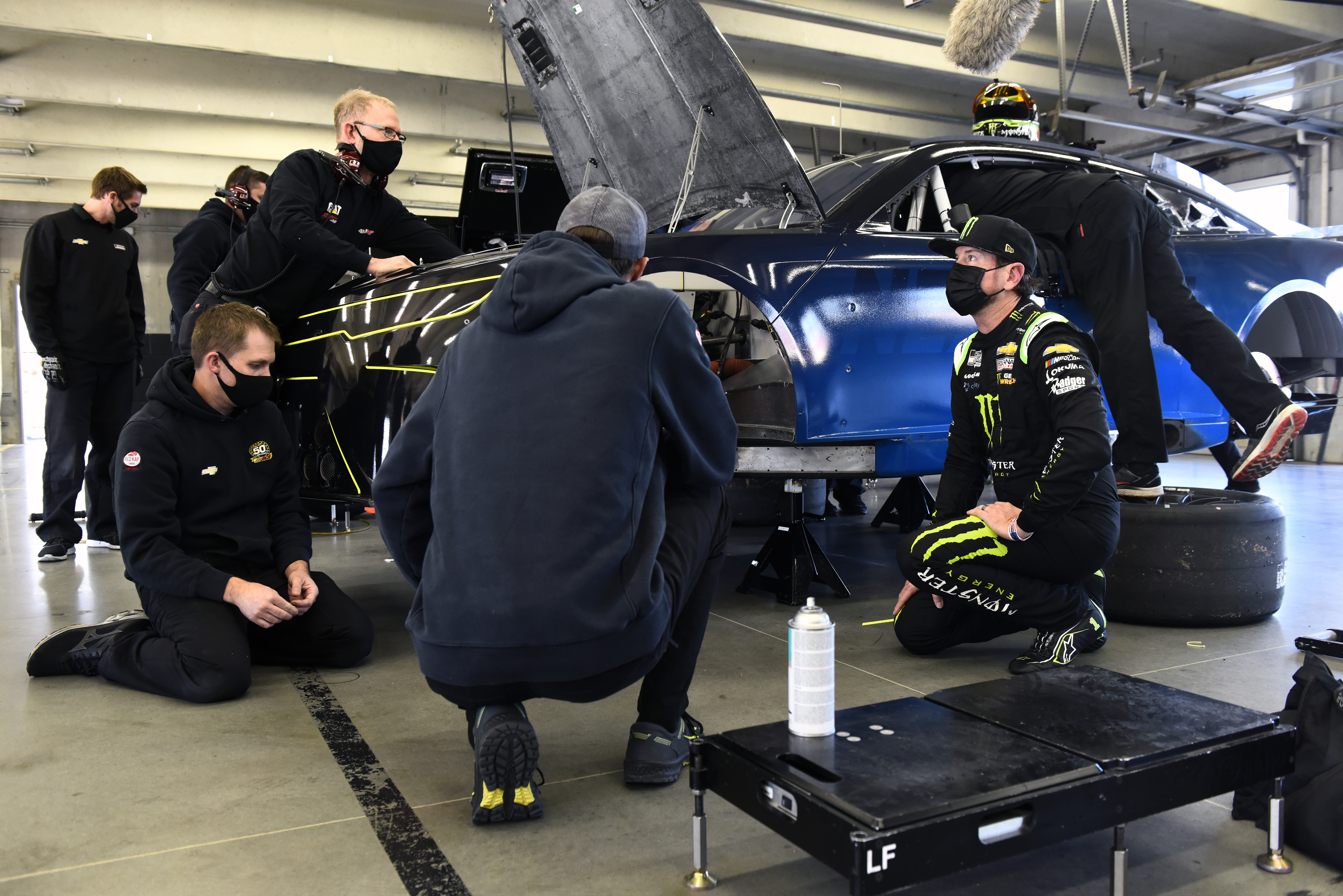 CONCORD, NORTH CAROLINA – NOVEMBER 16: Kurt Busch speaks with team members in the garage area during the NASCAR Cup Series test at Charlotte Motor Speedway on November 16, 2020 in Concord, North Carolina. (Photo by Jared C. Tilton/Getty Images) | Getty Images