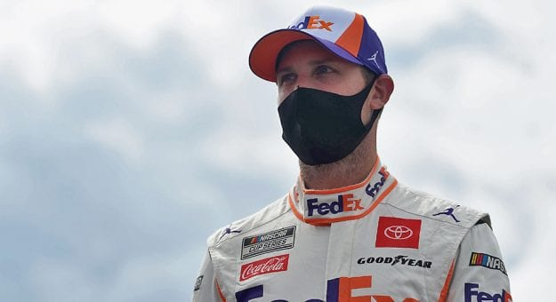 LONG POND, PENNSYLVANIA - JUNE 27: Denny Hamlin, driver of the #11 FedEx Ground Toyota, walks the grid prior to the NASCAR Cup Series Pocono Organics 325 in partnership with Rodale Institute at Pocono Raceway on June 27, 2020 in Long Pond, Pennsylvania. (Photo by Jared C. Tilton/Getty Images) | Getty Images