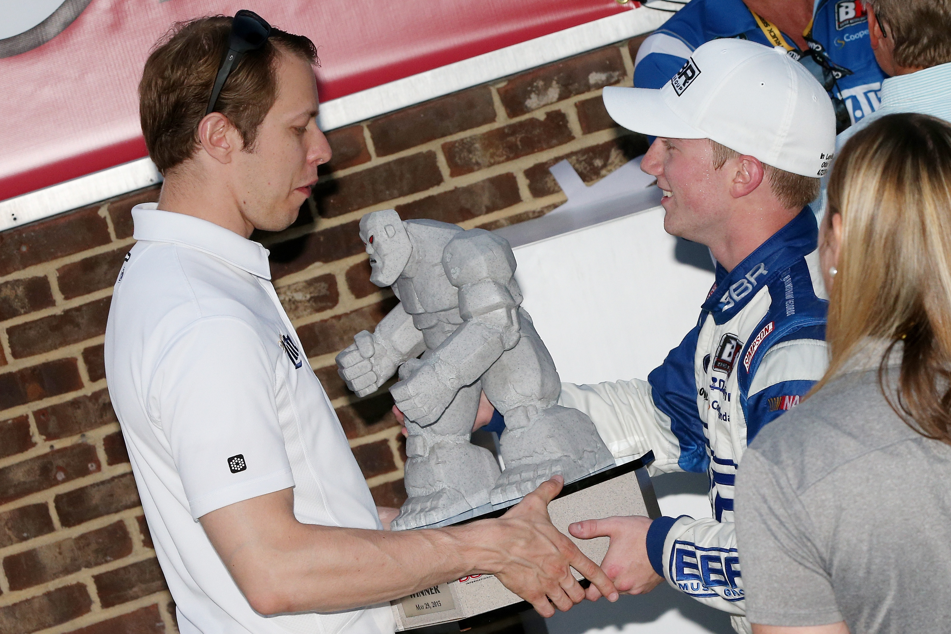 DOVER, DE – MAY 29: Tyler Reddick, driver of the #19 BBR Music Group Ford, right, celebrates with team owner and NASCAR driver Brad Keselowski in Victory Lane after winning during the NASCAR Camping World Truck Series Lucas Oil 200 at Dover International Speedway on May 29, 2015 in Dover, Delaware. (Photo by Sean Gardner/Getty Images)   Getty Images