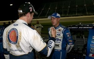 JOLIET, IL - SEPTEMBER 16: Daniel Hemric, driver of the #19 Draw-Tite Ford, talks with Brad Keselowski, driver of the #2 Miller Lite Ford and owner of Brad Keselowski Racing, on the grid prior to the NASCAR Camping World Truck Series American Ethanol E15 225 at Chicagoland Speedway on September 16, 2016 in Joliet, Illinois. (Photo by Sean Gardner/Getty Images) | Getty Images