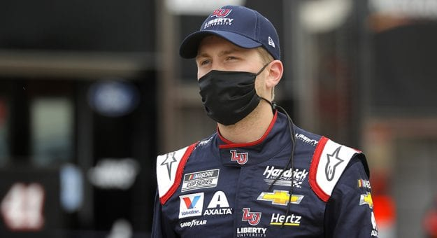 HAMPTON, GEORGIA - JUNE 07: William Byron, driver of the #24 Liberty University Chevrolet, walks the grid prior to the NASCAR Cup Series Folds of Honor QuikTrip 500 at Atlanta Motor Speedway on June 07, 2020 in Hampton, Georgia. (Photo by Chris Graythen/Getty Images) | Getty Images