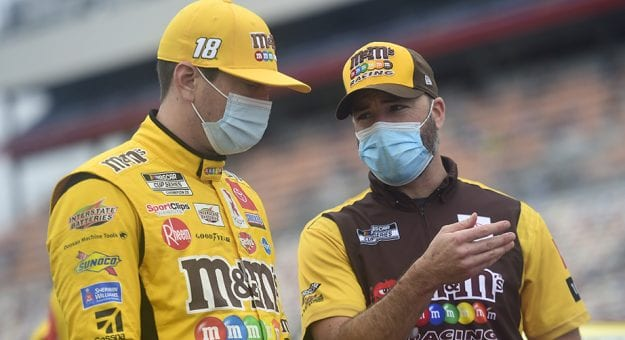 CONCORD, NORTH CAROLINA - OCTOBER 11: Kyle Busch, driver of the #18 M&M's Toyota, and crew chief Adam Stevens talk on the grid prior to the NASCAR Cup Series Bank of America ROVAL 400 at Charlotte Motor Speedway on October 11, 2020 in Concord, North Carolina. (Photo by Jared C. Tilton/Getty Images) | Getty Images