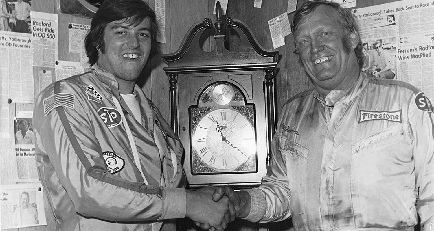 MARTINSVILLE, VA — October 27, 1974: After winning their respective races in the Cardinal 500 Classic at Martinsville Speedway, Ron Bouchard (L) and Ray Hendrick (R) pose with one of the grandfather clocks that are awarded to the victors. Bouchard won the NASCAR Modified portion of the event, while Hendrick took home the win in the NASCAR Late Model Sportsman race. (Photo by ISC Images & Archives via Getty Images)
