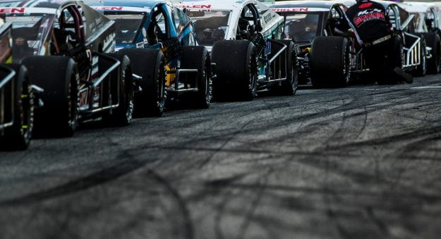 Cars line up on the grid before the White Mountain Showdown 200 for the NASCAR Whelen Modified Tour at White Mountain Motorsports Park in North Woodstock, New Hampshire on Saturday, August 1, 2020. (Adam Glanzman/NASCAR)