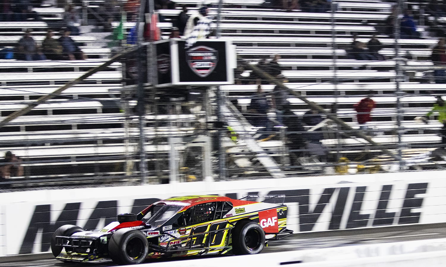 Eric Goodale, driver of the #58 GAF Roofing Chevrolet, wins the Virginia Is For Racing Lovers 200 for the Whelen Modified Tour at Martinsville Raceway in Martinsville, Virginia on April 8, 2021. (Adam Glanzman/NASCAR)