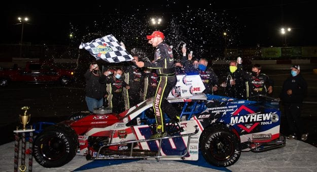 Doug Coby, driver of #10 Mayhew Tools Chevrolet celebrates with this crew after winning the Miller Lite 200 for the NASCAR Whelen Modified Tour at Riverhead Raceway in Riverhead, New York on May 15, 2021. (Kathryn Riley/NASCAR)