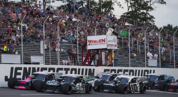 The green flag is waves to start the Laurel Highlands 150 for the NASCAR Whelen Modified Tour at Jennerstown Speedway in Jennerstown, Pennsylvania and wins on Saturday, August 22, 2020. (Nate Smallwood/NASCAR)