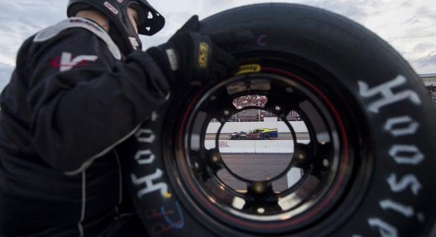 Walter Sutcliffe, Jr., driver of the #78 Last Minute Racing  Chevrolet, is seen through the hole of a tire during the Laurel Highlands 150 for the NASCAR Whelen Modified Tour at Jennerstown Speedway in Jennerstown, Pennsylvania and wins on Saturday, August 22, 2020. (Nate Smallwood/NASCAR)