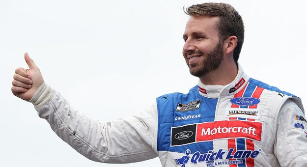 LOUDON, NEW HAMPSHIRE - JULY 18: Matt DiBenedetto, driver of the #21 Motorcraft/Quick Lane Ford, gives a thumbs up to fans on stage during pre-race ceremonies prior to the NASCAR Cup Series  Foxwoods Resort Casino 301 at New Hampshire Motor Speedway on July 18, 2021 in Loudon, New Hampshire. (Photo by James Gilbert/Getty Images) | Getty Images