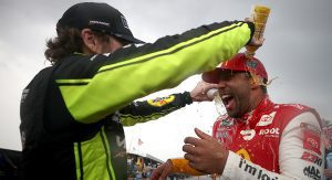 TALLADEGA, ALABAMA - OCTOBER 04: Bubba Wallace, driver of the #23 McDonald's Toyota, celebrates with Ryan Blaney, driver of the #12 Menards/Maytag Ford, on the grid after winning the rain-shortened NASCAR Cup Series YellaWood 500 at Talladega Superspeedway on October 04, 2021 in Talladega, Alabama. (Photo by Chris Graythen/Getty Images)   Getty Images